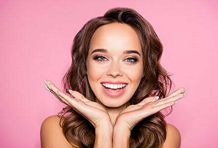 laser skin resurfacing for Aging, acne, pimples, wrinkles, oily, dry skin concept. Close up cropped photo of pretty excited lady with wavy hairdo, arm palms near face, happiness and freshness, purity